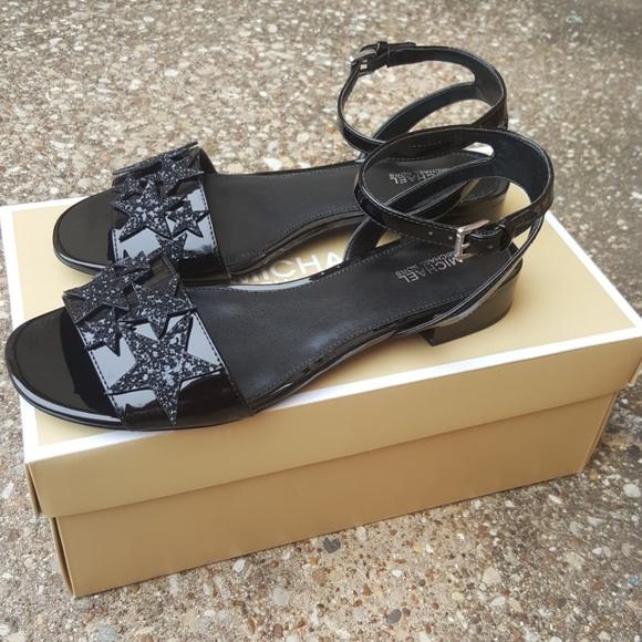 74e9ea291a3d Michael Kors Black Lexie Flat Sandal Patent 7. M 5a8882ab331627743e8e21d2